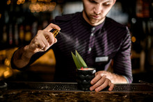 Male Bartender Spaying On A Bl...