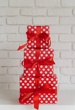 Pile Of Red Gift Boxes On Whit...