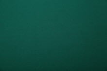 Dark Green Fabric Background With Copy Space For Your Text. Seamless Pattern. Color Empty Background.