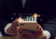 canvas print picture - Stock exchange market concept, hand trader holding smartphone with graphs analysis candle line on bokeh colors light in night.