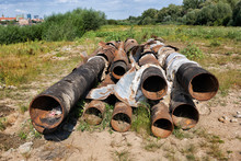 Pile Of Old Rusty Metal Pipes
