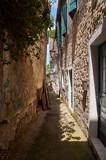Fototapeta Uliczki - narrow street in old town