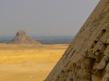 View Of The Base Of The Bent Pyramid With The Pyramid Of Amenemhat III (or Black Pyramid) In The Background. In Dahshur Necropolis, Cairo, Egypt