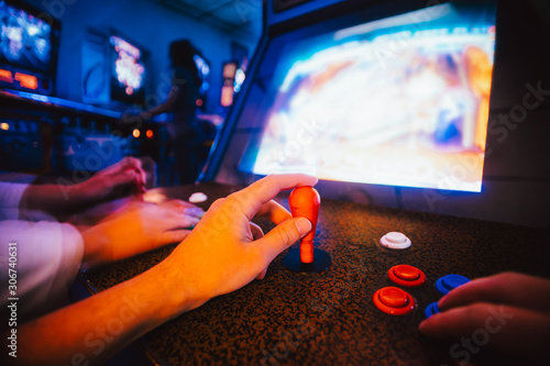 Detail on hands holding joysticks and playing an action game on an old vintage a Fototapet