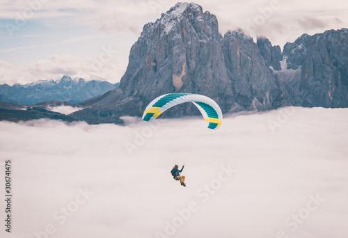 Fotografie, Obraz Paragliding over cloud inversion in Dolomites Italy