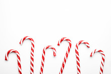 Frame Made With Christmas Candy Canes On White Background. Minimal Composition With Peppermint Candies. Top View