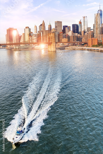 manhattan financial district  from manhattan bridge with boat, new york city