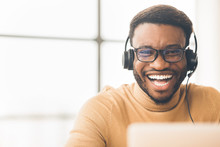 Closeup Of Happy African Customer Service Agent
