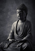 Meditating Buddha Statue On Dark Background. Copy Space.