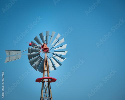 Antique windmill on a texan farm with clear sky on a sunny day