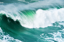 Big Ocean Wave Crashing Near The Coast. Beautiful Nature Background