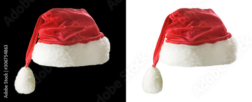 Obraz Image of red christmas hat on a white and black background - fototapety do salonu