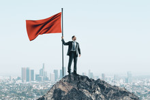 Happy Businessman With Red Flag