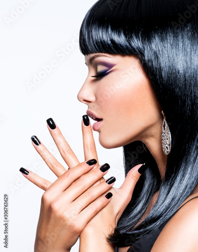 Fotografering Beautiful woman with black nails and fashion makeup of eyes.