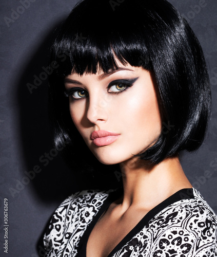 Beautiful woman with bob black straight hair.