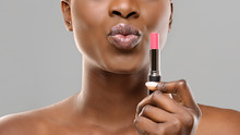 Black Woman Holding Pink Lipst...
