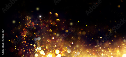 Golden Christmas and New Year glittering stars swirl on black bokeh background, backdrop with sparkling golden stars, holiday garland, magic glowing dust, lights. Gold Abstract Glitter Blinking sparks - 306764804
