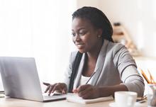 Smiling Black Businesswoman Wo...