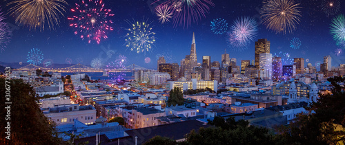 Downtown San Francisco cityscape with Bay Bridge in a bright night/late sunset Wallpaper Mural