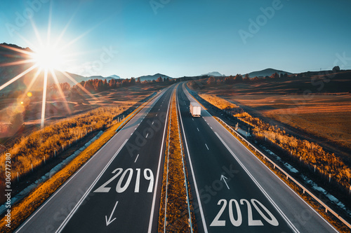 fototapeta na szkło Driving on open road at beautiful sunny day to new year 2020. Aerial view