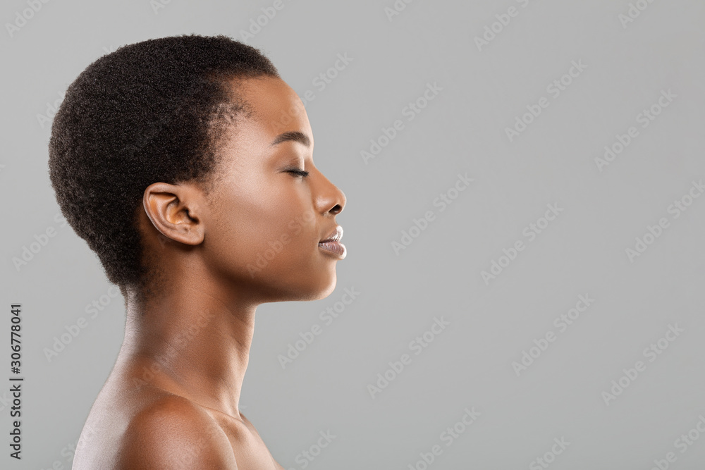 Fototapeta Profile portrait of black woman with perfect skin and closed eyes