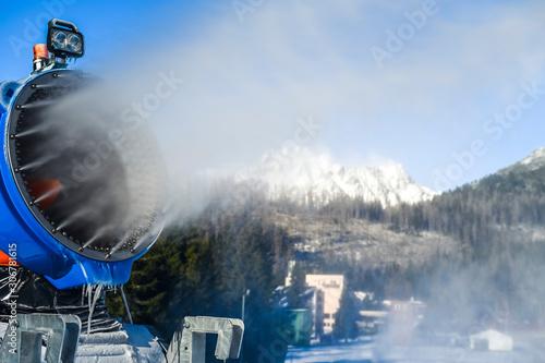 Fotografia Snow cannon in winter mountains