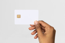 Studio Shot Of Ethnic Hand Holding A Credit Card