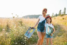 Sunny Nature, Mom And Daughter Paint A Picture In A Park , Painting A Little Child, Child Creativity. Mother's Day