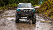British Columbia, Canada. Off-road Monster Truck In The Forest.