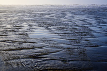 Pattern And Texture In The Retreating Water And Wave Action As A Nature Background, Ocean Shores, Washington State, USA