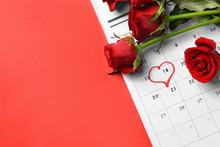 Calendar And Rose Flowers On Color Background. Valentine's Day Celebration
