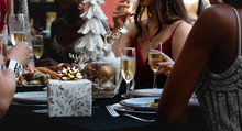 Female Woman Champagne Glass And Gift Box On The Table Fashion Xmas Christmas Party At Restaurant Dishes Plats Dinner Christmas Decoration Holiday