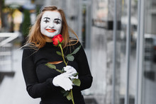 Woman Mime With Red Rose