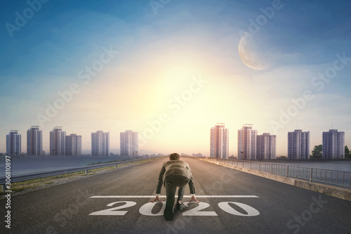 Fototapeta Asian business person ready to run new year 2020 toward the city. Business concept obraz
