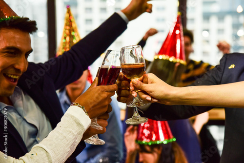 Fotografie, Obraz  Business men and women with glasses of champagne and wine celebrating Christmas