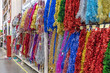 Christmas colorful tinsel closeup on the counter in the store.