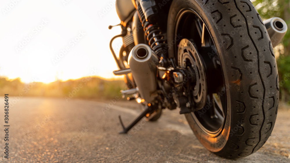 Fototapeta motorcycle in a sunny motorbike on the road riding.with sunset light. copyspace for your individual text. Triumph motorcycle.