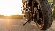 Motorcycle In A Sunny Motorbike On The Road Riding.with Sunset Light. Copyspace For Your Individual Text. Triumph Motorcycle.