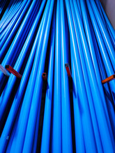Stacks Of Blue PVC Water Pipes...