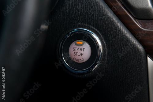 Button start and turn off the ignition of the car engine close-up on the dashboard, electric key, of modern design black and with elements chrome on the interior panel Tapéta, Fotótapéta
