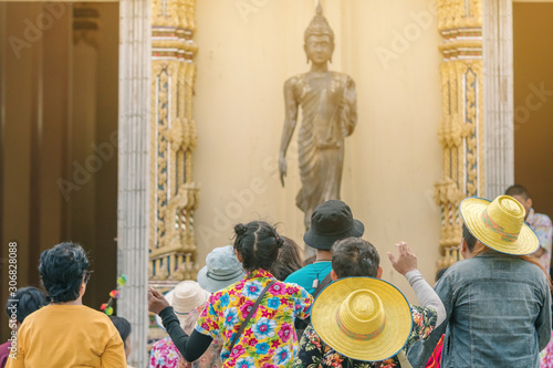 Fototapeta  Group of people wait for coins wrapped in ribbons from new monk in ordination ce