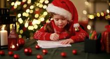 Happy Child Girl Writing Letter Santa Home Near Christmas Tree.