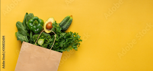 Shopping bag full green vegetables on yellow background with copy space  Purchas Lerretsbilde