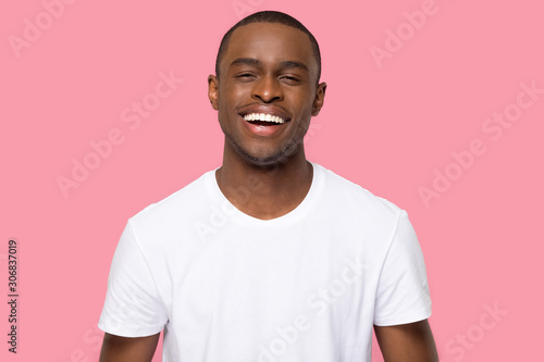 Head shot portrait smiling African American man looking at camera