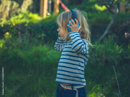 Canvas Print Toddler with ear defenders in garden