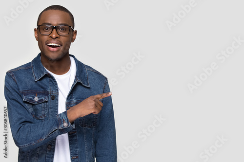 Obraz Happy African American man pointing finger at copy space - fototapety do salonu