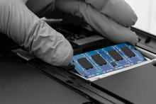 Technician Installing RAM Into...