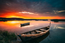 Braslaw Or Braslau, Vitebsk Voblast, Belarus. Wooden Rowing Fishing Boats In Beautiful Summer Sunset On The Dryvyaty Lake. This Is The Largest Lake Of Braslav Lakes. Typical Nature Of Belarus