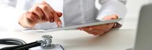 Female Doctor Hold Digital Tab...