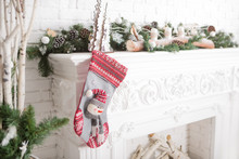 Christmas Sock With Gifts On The Fireplace